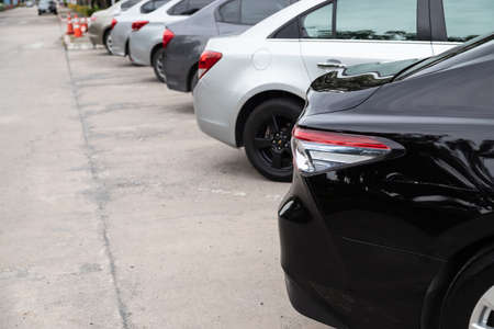 Car parking in line and car running background.