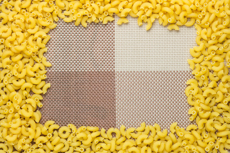 unprocessed: The macaroni raw, unprocessed ingredients and put into a picture frame. Stock Photo