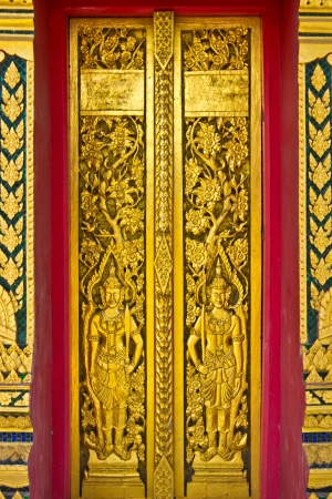 art door at Temple, Lampang in Thailand photo