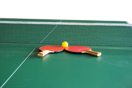 Table tennis paddles and ball Stock Photo