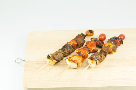 Delicious skewers on garden grill, barbecue time. Stock Photo