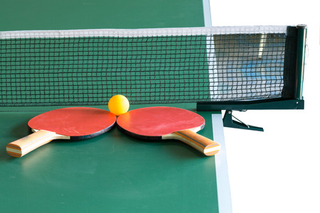 Two table tennis rackets and balls on a green table with net; shallow DOF, focus on rackets Stock Photo