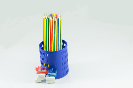 Colored pencils in a pencil case on white background