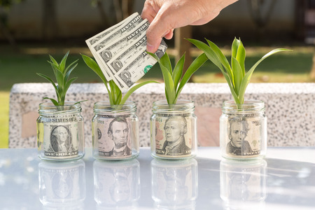 Hands holding us dollar bills