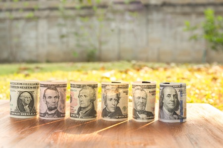 one hundred and ten: Portraits of America presidents and politicians from dollars isolated on white background. Stock Photo