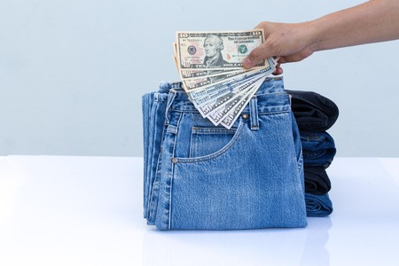 Blue jeans on white background. Color jeans fashion and dollar business concept.