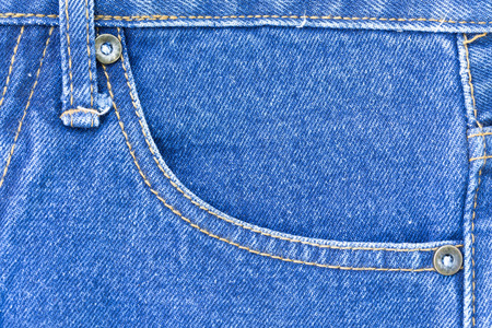 texture of denim with macro concept. Blue jeans is the classic one fashion that all people love it. This image can apply for background,backdrop including business of clothing and artwork design.