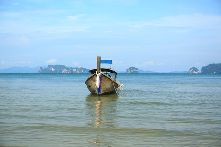 long tail boat Thailand and fisherman Stock Photo