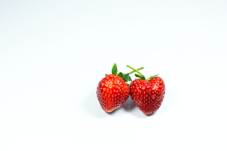 Strawberry. Fresh strawberry. Red strewberry. Strawberry Juice. Loosely laid strawberries in different positions. Stock Photo