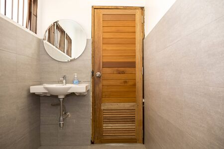 Spacious bathroom in gray tones with heated floors, freestanding tub, walk-in shower, double sink vanity and skylights. 写真素材