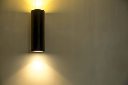 Interior design, indoor lamps and electricity concept - black lamp in a room, elegant modern home decor lighting