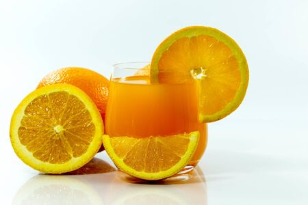 Navel orange juice and slices of orange with on white background