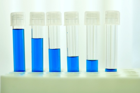 chemic: Blue solution in the test tubes Stock Photo