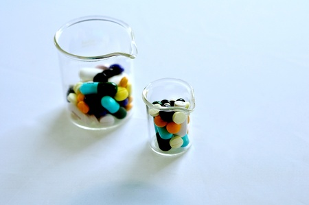 A colorful pills in the beaker photo
