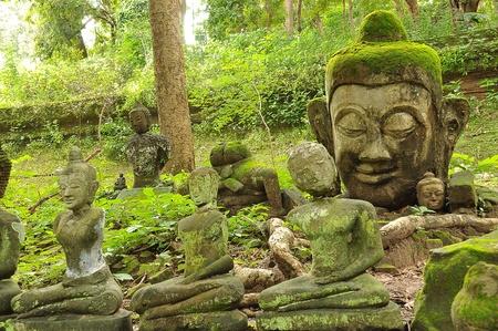 outworn: Head of Buddha in U-Mong Temple, Chiangmai, Thailand
