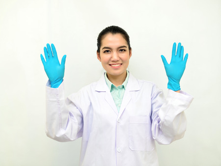 technologist: Asian female medical technologist show a glove, Laboratory protective equipment concept