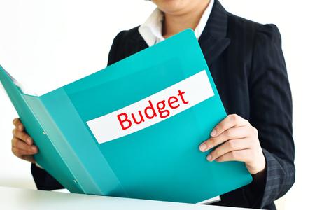 account executive: Secretary holding budget document file