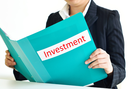 account executive: Female manager holding investments document file Stock Photo