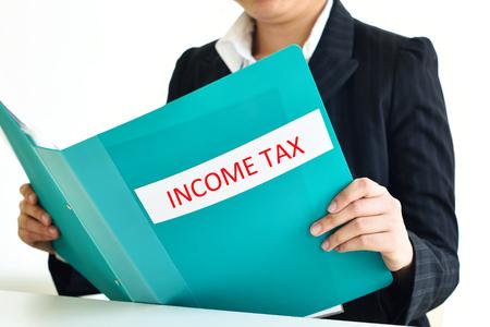 account executive: Secretary holding income tax document file Stock Photo