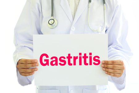 gastritis: Doctor holding Gastritis card in hands Stock Photo