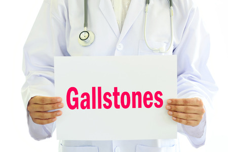 bile: Doctor holding Gallstones card in hands Stock Photo