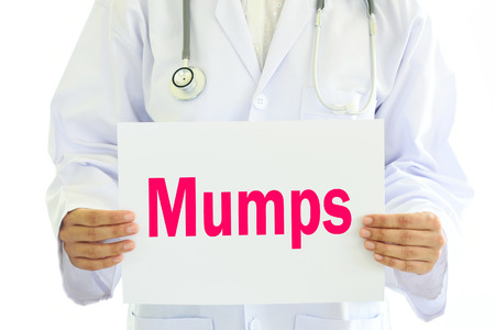 mumps: Doctor holding Mumps card in hands