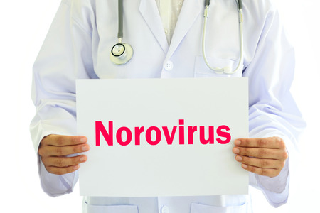 norovirus: Doctor holding Norovirus card in hands