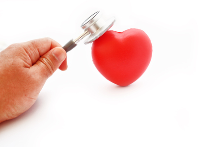 Heart with stethoscope on white background, heart healthy concept Stock Photo