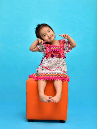 Portrait of Asian girl with blue background