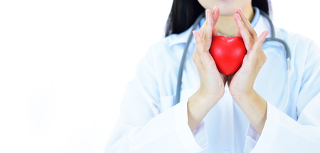 Asian female cardiologist with heart
