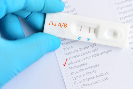 Influenza AB positive test result by using rapid test cassette