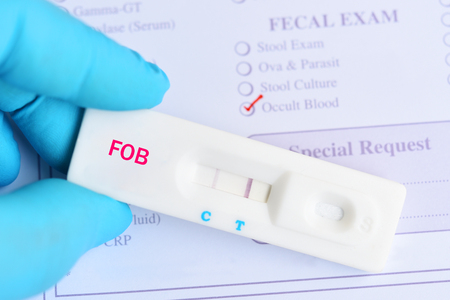 Fecal occult blood test positive by using rapid test cassette Stock Photo