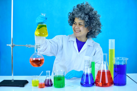 Old female scientist working with chemical in research laboratory Stock Photo