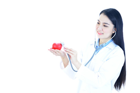 Asian female doctor holding heart in hands