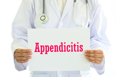 Doctor holding appendicitis card in hands