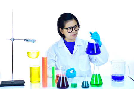 Asian female scientist working with chemical in research laboratory