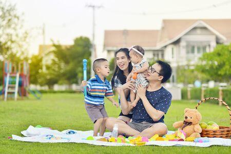Portrait of Asian family in garden