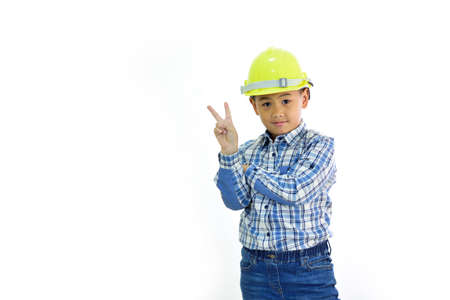 Cute Asian boy 7 years old with engineer uniform, white background