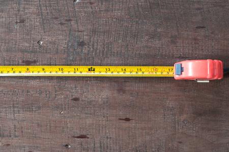 amplitude: Measuring Tape on wood board