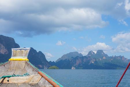 Wooden boat in Ratchaprapha dam, Surat Thani, Thailand.