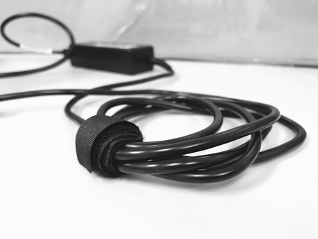 wire: Black power cable for laptop on the desk. Stock Photo