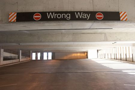Wrong way sign inside an empty parking garage