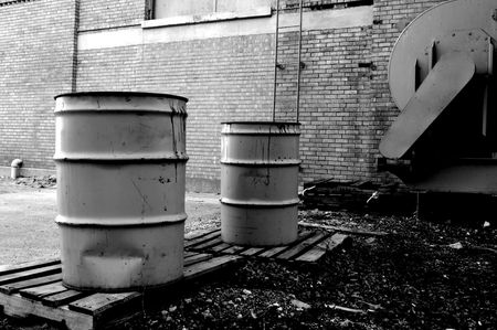 Waste barrels in an alley photo