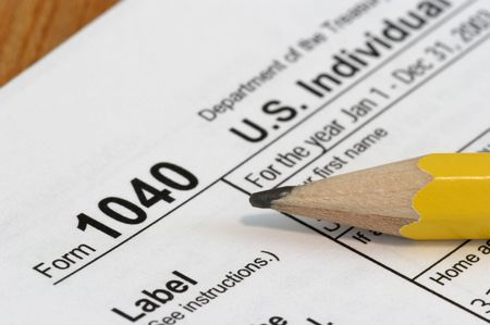 deduct: Close view of a pencil and a US tax form 1040