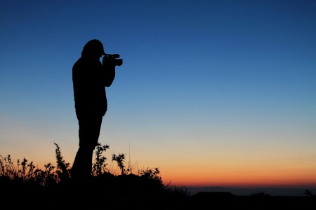 The Cameraman, Silhouette of Man with Video Camera at Sunset photo