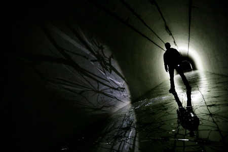 tunnels: silhouette in a underground bunker from cold war Stock Photo