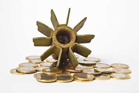 artillery shell: Money for War Concept, Exploded Artillery Shell and coins