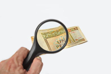 pesos: Magnifying Glass on the one One Cuban Pesos Stock Photo