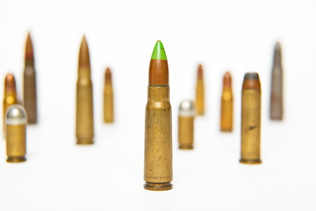 9mm ammo: A selection of bullets isolated on white.