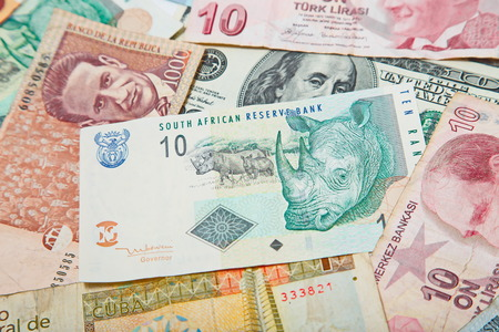 rand: Background from paper money of the different countries. South african Rand in the middle